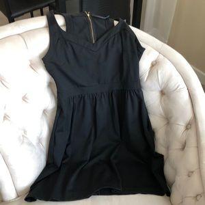 Black racer back pocketed flounce dress